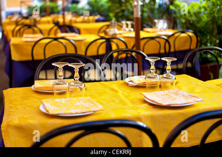 glasses on table - tables on the street, italian restaurant - Rome, Italy - Stock Photo