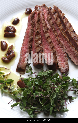 Top rump steak tender herbs and warm olive oil sauce A g steak will be plentyeach person Ask your butcher to cut - Stock Photo