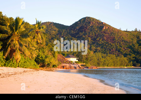 Anse La Blague, Praslin, Seychelles. View along the beach, sunrise. - Stock Photo