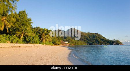 Anse La Blague, Praslin, Seychelles. View along the beach, early morning. - Stock Photo