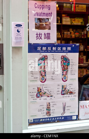 Notice in window of Chinese medicine shop, Soho, London - Stock Photo