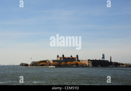Blue sky view, from stern of Circle Line Cruise Boat, brown autumn trees Ellis Island Immigration Museum, New York - Stock Photo
