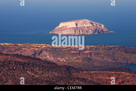 Very small island off the coast of Santorini, Greece - Stock Photo