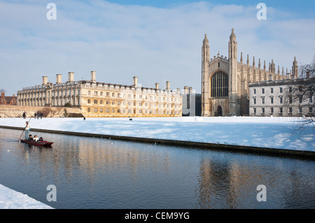 Punting along river Cam in winter snow with Kings College Chapel to the rear. Cambridge, England. - Stock Photo