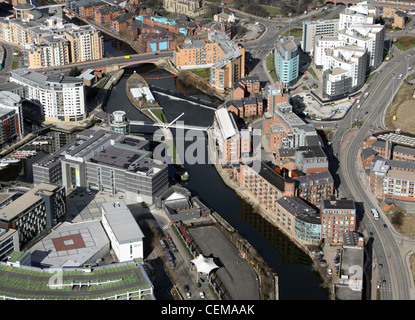 aerial view of the River Aire in Leeds as it runs passed Leeds Dock & The Royal Armouries Museum - Stock Photo