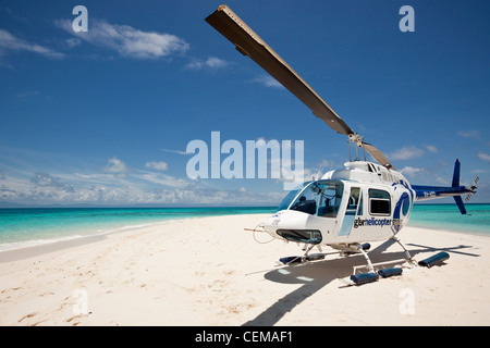 Helicopter on Vlassof Cay - a sand cay off the coast of Cairns. Great Barrier Reef Marine Park, Queensland, Australia - Stock Photo