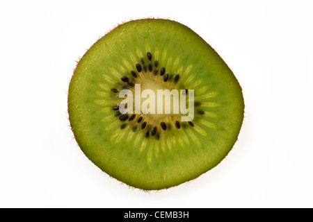 Overhead view of slice of kiwi fruit on plain background - Stock Photo