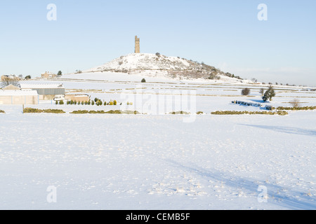 Snow scene in the Pennines with Castle hill near Huddersfield, West Yorkshire - Stock Photo
