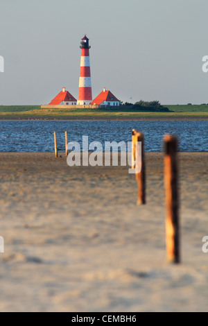 Westerhever lighthouse seen from beach in St. Peter-Ording - Stock Photo