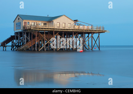 Restaurant Strandbar 54° Nord built on stilts on the St. Peter-Ording beach, Germany - Stock Photo