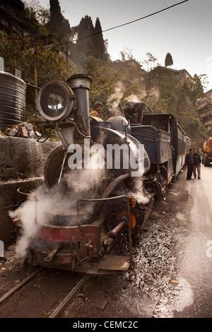 India, West Bengal, Darjeeling Himalayan Mountain Railway steam train taking on water - Stock Photo