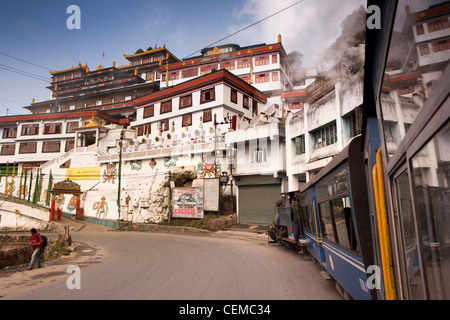 India, West Bengal, Darjeeling Himalayan Mountain Railway steam train passing Druk Sa Ngag Choeling monastery - Stock Photo