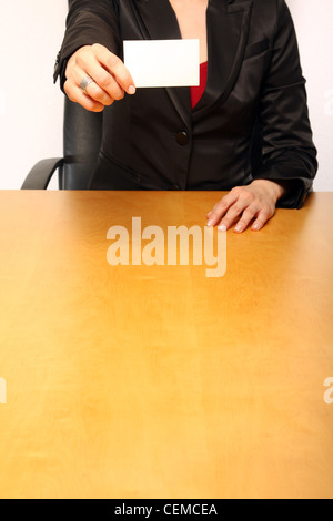 View of a business-womann showing her card (blank) - Stock Photo
