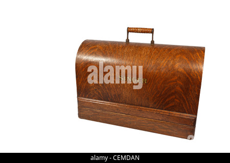 Old fashioned sewing machine under wooden lid - Stock Photo