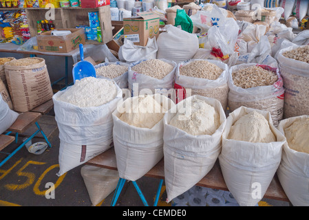 Open sacks of grains are on display for sale at the public market in Pujili, Ecuador. - Stock Photo