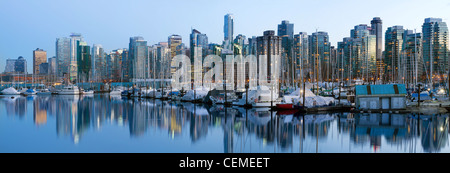 Vancouver BC Canada Skyline and Marina along False Creek at Blue Hour Panorama - Stock Photo