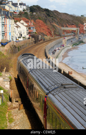 First Great Western HST train passes along the sea wall at Dawlish - Stock Photo