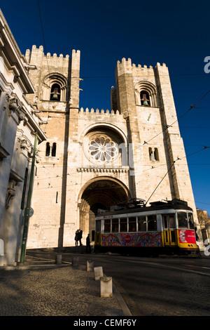 Historic tram in front of Lisbon Cathedral (Sé de Lisboa). Lisbon, Portugal. - Stock Photo
