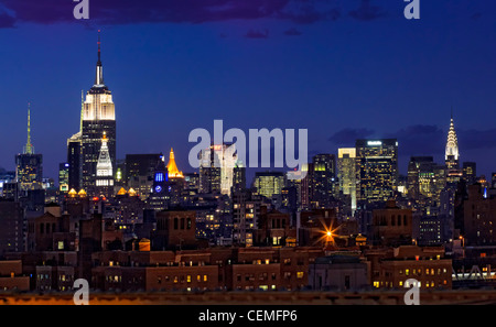 Evening Manhattan skyline of New York City. Empire State Building on the left, and Chrysler building on the right. - Stock Photo
