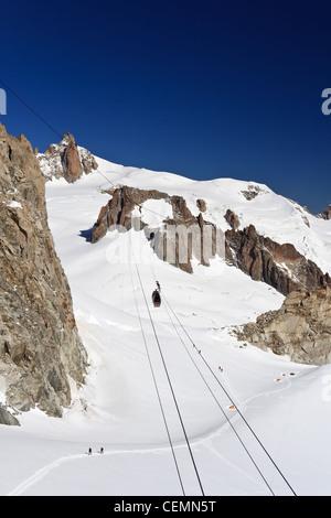 summer view of Aiguille du Midi peak and Mer di Glace glacier in Mont Blanc massif - Stock Photo