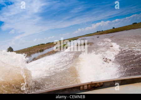 Airboat in the marshes in Everglades national park - Stock Photo