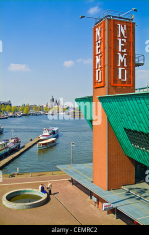 NEMO interactive museum in Amsterdam harbour Oosterdok Netherlands Holland EU Europe - Stock Photo