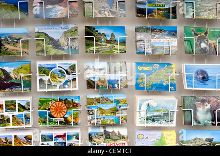 Postcards for sale outside a shop in Tintagel, Cornwall, England, UK - Stock Photo