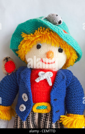 Knitted doll - wurzel gummidge scarecrow set against white background - Stock Photo