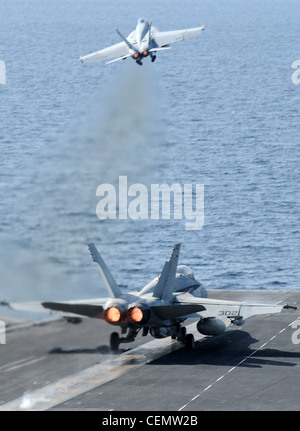 ARABIAN SEA (Feb.16, 2012) An F/A-18C Hornet assigned to the Vigilantes of Strike Fighter Squadron (VFA) 151 and - Stock Photo
