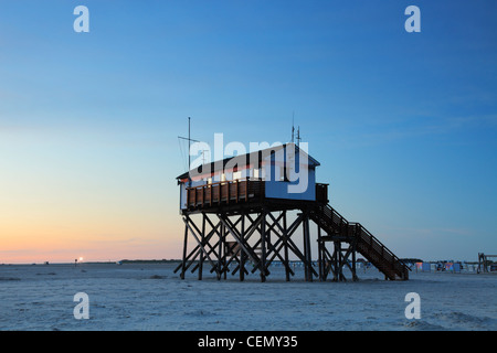 bay watch building built on stilts on the St. Peter-Ording beach; in the background the light of the Westerhever - Stock Photo