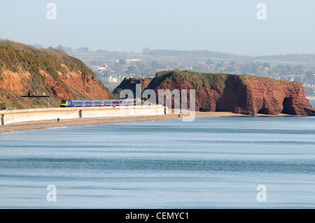First Great Western HST train passes Langstone Rock on the sea wall between Dawlish and Dawlish Warren - Stock Photo