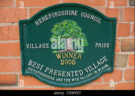 english village uk BEST PRESENTED VILLAGE 2005 sign in picturesque village of Weobley Herefordshire England UK - Stock Photo