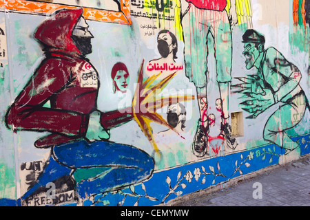 wall painting of revolutionary fighter attacking soldier, Mohamed Mahmoud street, near Tahrir Square, Cairo, Egypt - Stock Photo