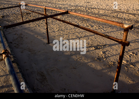 rusty metal bars on beach - Stock Photo