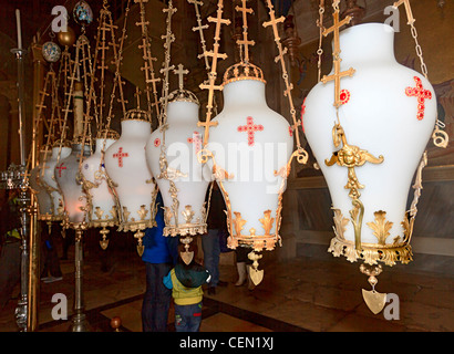 Lanterns above the Stone of Unction in the Church of the Holy Sepulchre, Old City Jerusalem, Israel - Stock Photo