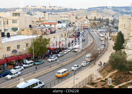 View of Jerusalem street from the Ramparts, the wall that surrounds the Old City Jerusalem in Israel. - Stock Photo