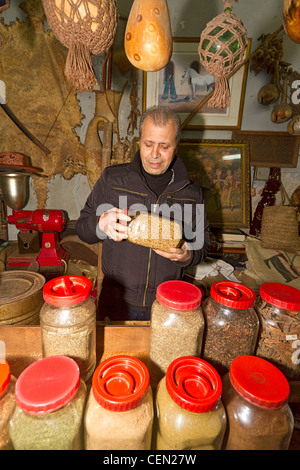 Spice merchant in a shop in the market at the Old City of Akko (Acre), an ancient port city in Israel. - Stock Photo
