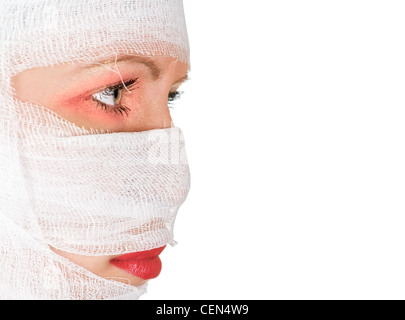 girl with bandages on her face on white - Stock Photo