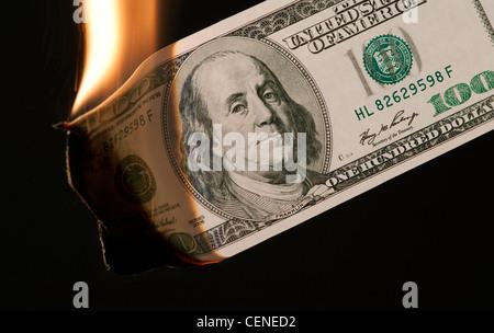 burning money US 100 dollar bill - Stock Photo