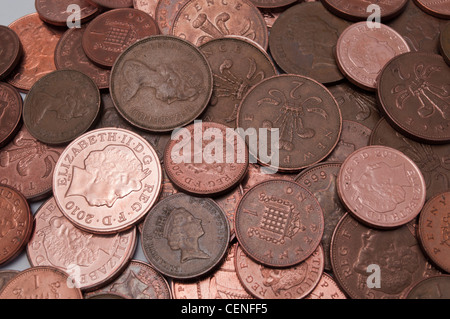 Pile of UK money, copper coins including one and two pence pieces - Stock Photo