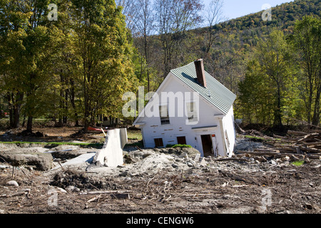 A house washed off its foundation due to flood damage in Warren Vermont along the Mad River in 2011 - Stock Photo