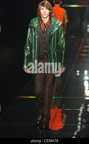 Burberry Milan Menswear Ready to Wear Autumn Winter Green raincoat, patterned cardigan and checked trousers - Stock Photo