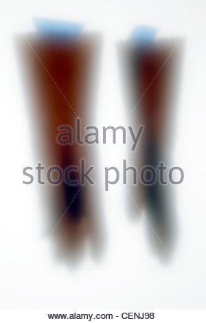 outline of household working gloves with blue tape - Stock Photo