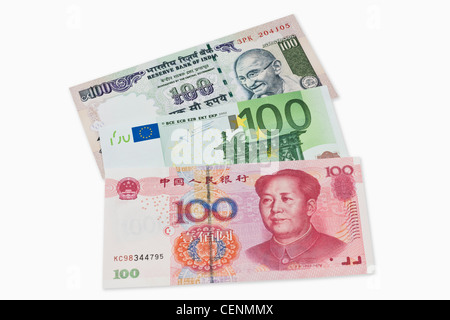 Three bills worth 100 Indian rupees, 100 Euro and 100 Chinese yuan lie side by side. - Stock Photo