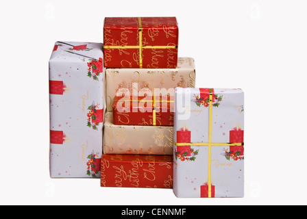 A pile of presents gift wrapped in Christmas paper. - Stock Photo