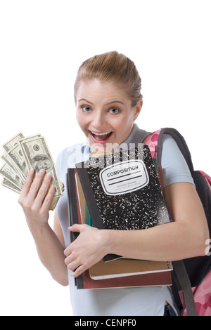 education financial aid Caucasian college student holds 100 (hundred) dollar bills happy getting money help subsidies - Stock Photo