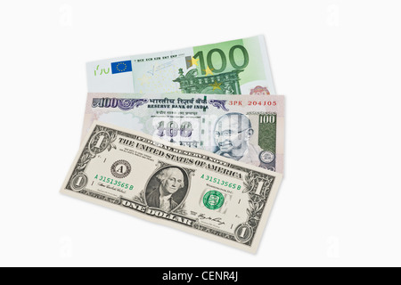 Three bills worth 100 Indian rupees, 100 Euro and 1 U.S.Dollar lie side by side - Stock Photo