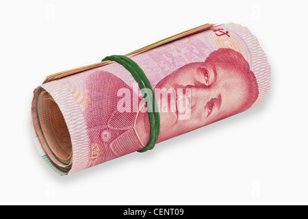 many 100 Yuan bills, rolled up and held together with a rubber. The renminbi, the Chinese currency, was introduced - Stock Photo