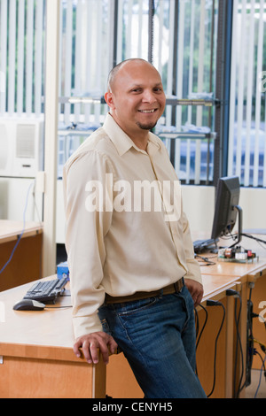 Hispanic engineering student in computer lab - Stock Photo