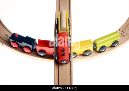 Symbol image. Wooden toy trains on rails. - Stock Photo